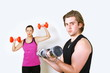 Exercising couple with focus on man