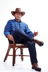 A cowboy with a glass of whiskey
