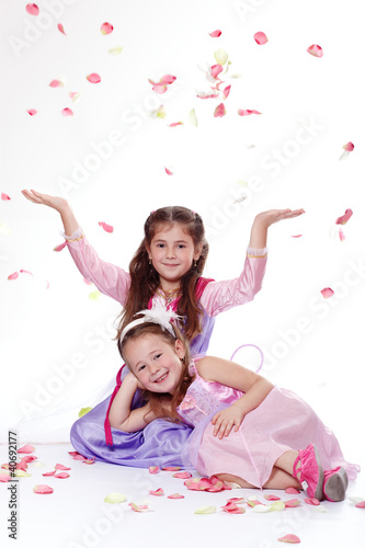 Two young princesses with flying petals