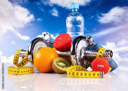 fitness dumbbells, hand grip, water and fruits