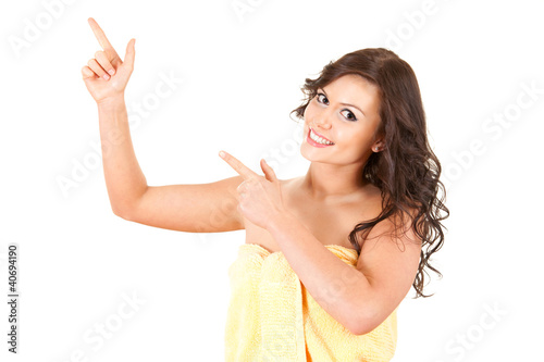 pointing up young woman in towel, white background