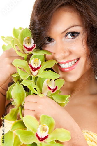 beautiful girl with orchid flowers, white background