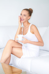 Woman with beautiful smile drinking coffee