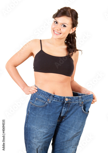 girl showing how much weight she lost
