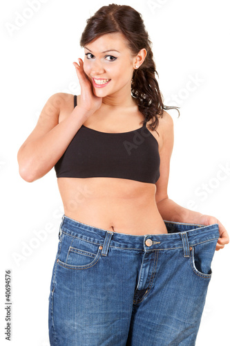 young woman in trousers showing how much weight she lost