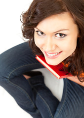 happy student girl with book looking at camera, high angle view