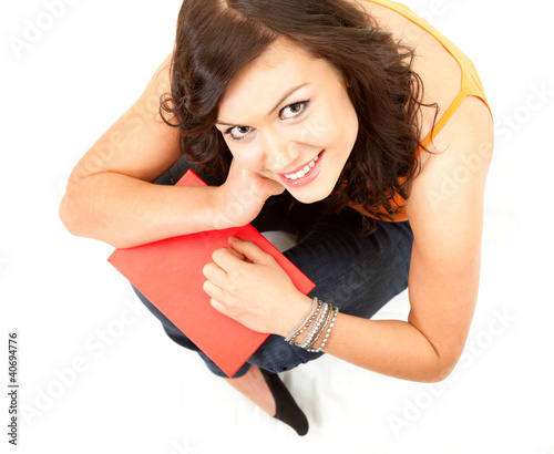 cheerful student girl with book looking at camera