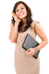 smiling girl in dress keeping laptop, white background