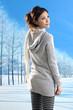 Winter fashion girl posing in winter park