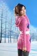 fashion asian girl posing in winter park