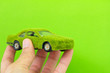 Holding Eco car icon isolate on green background