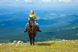 rider on horseback at mountains