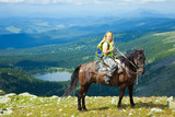 Female rider  at mountains