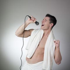 bare-chest athlete singing
