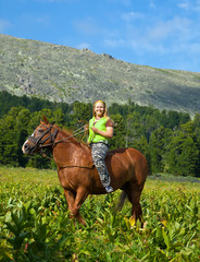 Female rider riding a horse bareback