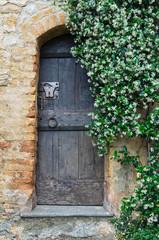 Wooden door. Vigoleno. Emilia-Romagna. Italy.