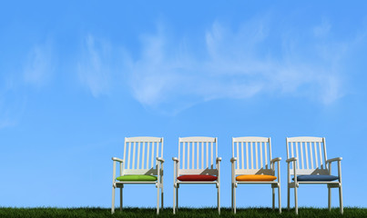 Four   white chair on grass