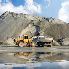 Excavator and truck in mine.