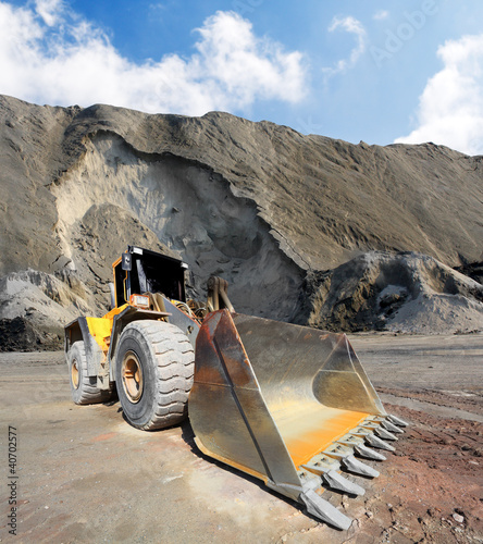Big excavator in mine.