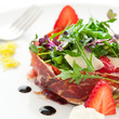 Green salad with spanish ham.