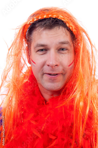 Man is posing in orange outfit for soccer game