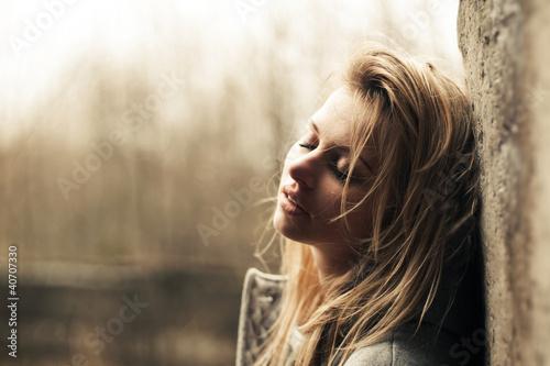 beautiful girl near the wal