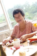 Senior woman enjoying her dining