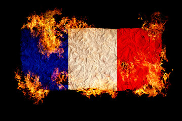 French flag in fire.