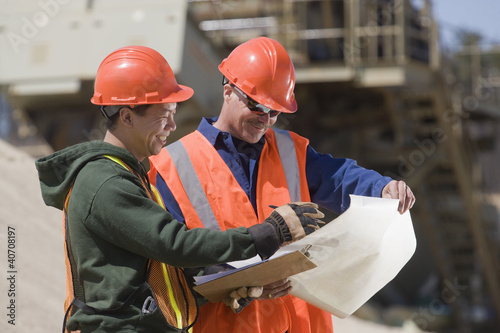 Two engineers planning at a gravel and asphalt plant