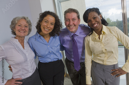 Portrait of business executives smiling together