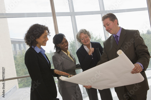 Business executives discussing a blueprint
