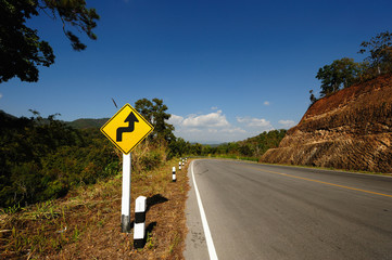 Upcoming Bends Road Sign and Landscape
