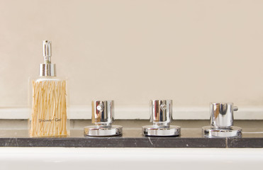 Modern stainless steel taps with shower gel