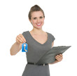 Smiling realtor holding clipboard and giving keys isolated