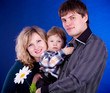 Beautiful young family with baby boy and flower