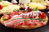 Fototapety Salami and cheese platter with herbs