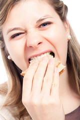 Hungry woman eating sandwich