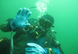 Scuba diver in freshwater. Diving in cold depth lake.