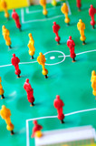 Macro shoot of red and yellow players of tabletop football game. poster