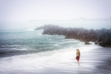 Depression and sadness concept - woman and foggy sea