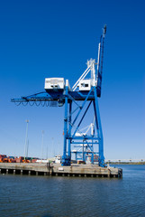 Steel cargo crane with shipping containers