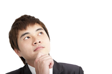 Young asian businessman thinking portrait isolated on white .