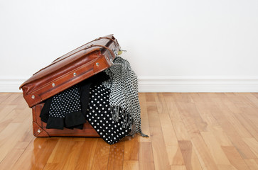 Polka dot clothing in a retro suitcase
