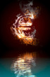 euro symbol burning, fire with reflection in water
