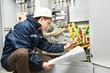 Leinwandbild Motiv Electrician checking cabling power line