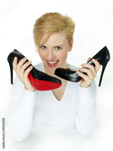 Young female is happy to have a pair of High Heels