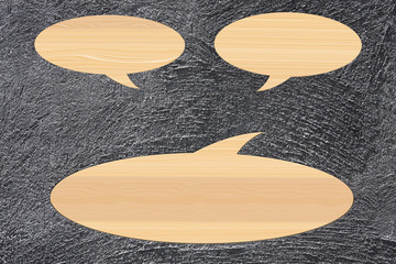 wooden speech bubble on cement background