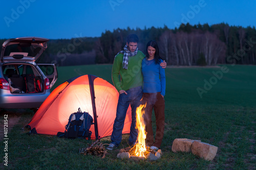Tent camping car couple stand by bonfire