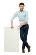Businessman standing with blank billboard
