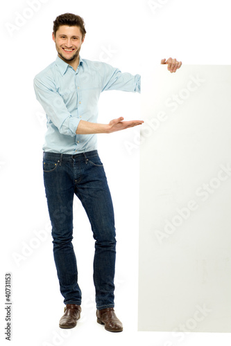 Businessman standing with blank billboard